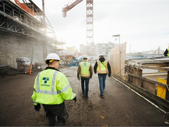 Construction at Roosevelt Station is about 70 percent complete. Crews are focused on finishing the station entrances, or headhouses, seen here on the left. Sound Transit