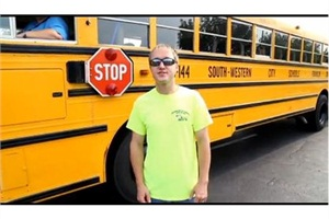 "In ""School Bus Jive,"" driver Ron McClure II addresses South-Western City Schools' bus safety rules, including how to safely board the school bus."