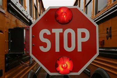 A package of proposed bills in Michigan aims to enhance school bus safety by restricting who can board and stiffen penalties on those who do so unlawfully, crack down on motorists who illegally pass buses, and allow stop-arm cameras. File photo courtesy Lois Cordes