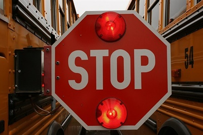 The Georgia Senate passed a bill to change a provision that apparently let motorists pass a stopped school bus if they are on the opposite side of a highway divided only by a turn lane. File photo courtesy Lois Cordes