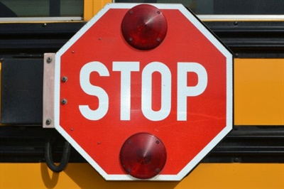 Gov. Brian Kemp signed into law a bill that reverses a provision that had apparently loosened the requirement for when motorists had to stop for a stopped school bus. File photo