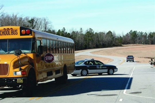 During School Bus Safety Week, Texas state troopers will be riding on or following school buses to catch motorists who illegally pass them. [Photo from North Carolina Operation Stop Arm]