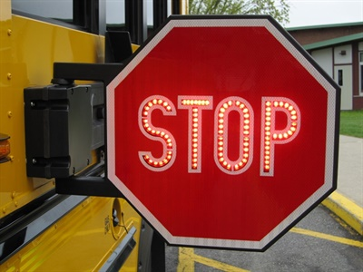 S4524B would allow the use of stop-arm cameras to help law enforcement catch and prosecute motorists who illegally pass stopped buses. Photo courtesy NYSBCA
