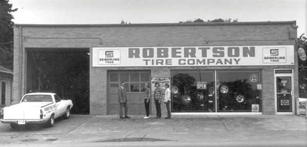 Robertson Tire founder Ted Robertson is at the far left in this circa-1964 photo.