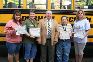 From left: Durham School Services drivers Marie Tillson, Suzanne Swayze, Beatriz Derubis and Sheila Dawson received certificates of appreciation from Second Hill Lane Elementary School Principal James Noga for their work in Durham's Adopt-a-School program.