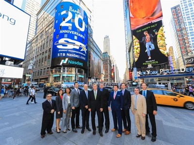 Student Transportation Inc. execs gather in New York City as a giant Nasdaq display highlights the company's 20th anniversary.
