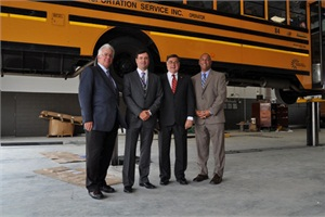 From left: Suffolk Transportation Service Executive Vice President Tom McAteer, CEO John Corrado, Brookhaven Town Supervisor Ed Romaine and Brookhaven Industrial Development Agency Deputy Director Jim Tullo attend the unveiling of Suffolk Transportation's new school bus hub.