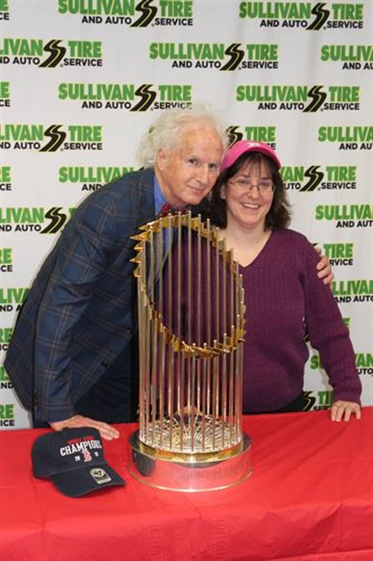 Sullivan Tire Vice President Paul Sullivan poses with the trophy alongside Red Sox fan Susan Lowell of Carver, Mass.