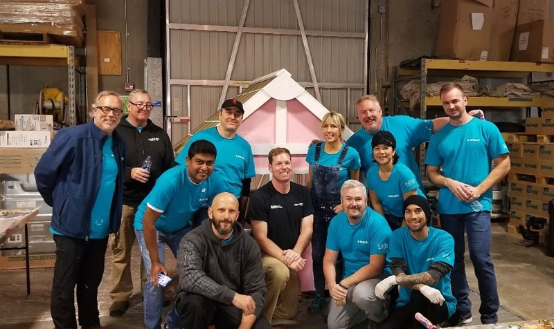 Managers and executives from Sumitomo Rubber North America built a child's playhouse to help raise funds for the San Diego Habitat for Humanity.