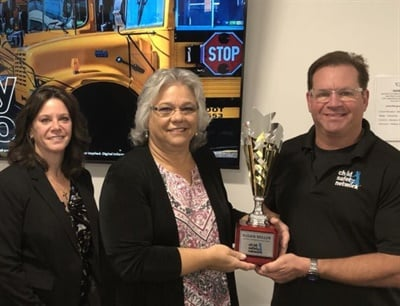 Susan Miller, Colorado's head of pupil transportation (center), receives an award for her school bus security training efforts from Ward Leber, the founder of Child Safety Network. Also shown isAndrea Di Spirito, a TSA trainer. Photo courtesy Child Safety Network