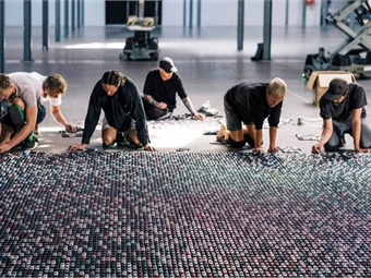 A 47-foot-long and 14-foot-wide installation of toy cars, used to illustrate removing 30,000 cars from the road, took five people over 24 hours to finalize.