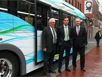 TARC Executive Director J. Barry Barker, Proterra President/CEO Ryan Popple and Mayor Greg Fischer (left to right) in a 2015 photo launching the agency's zero-emission bus fleet. Courtesy Transit Authority of River City