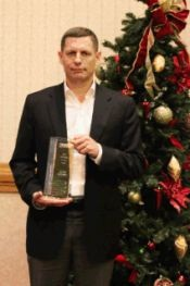 John Julian of Julian Electric accepts the Supplier of the Year award from Thomas Built Buses.