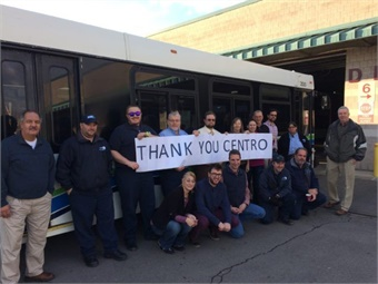 Upon the request of TCAT GM Scot Vanderpool, (shown above far right with TCAT staff) Centro CEO Rick Lee last week quickly agreed to lend two 40-foot 2005 New Flyer diesel buses, which TCAT bus operators and a mechanic transported back to Ithaca on Fri., Dec. 1. Photo: TCAT