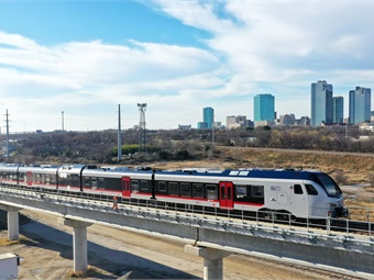 TEXRail commuter rail line with Fort Worth, Texas skyline. Photo: Trinity Metro