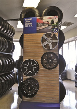 Modern tire and wheel displays include posters that showcase the store's history, which dates back to 1978.