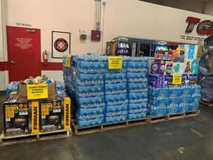 The TGI warehouse in Miami was a collection spot for water and other necessities to help those affected by Hurricane Dorian.