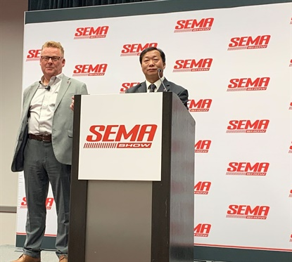 Tony Davenport, left, and Miller Feng, talk about the joint venture between two TPMS manufacturers -- Huf and Shanghai Baolong.