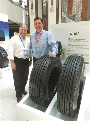 Triangle Tire USA Chairman Manny Cicero, left, and Tredroc Tire Services Inc. CEO John Boynton check out the general purpose TRD02 drive tire in China. Triangle can deliver tires to Tredroc from its new warehouse in Madison, Tenn.