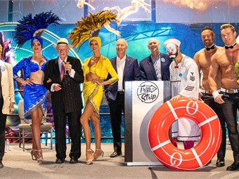 """(L to R) Keolis Western Regions VP of Operations Francis Julien, City of Las Vegas Mayor and RTC board member Carolyn Goodman, Vegas showgirls, former Las Vegas Mayor and brand ambassador Oscar Goodman, LVCVA CEO & President Steve Hill, Clark County Commissioner and RTC Chairman Larry Brown, """"O"""" by Cirque du Soleil performer, Chippendales, celebrity impressionist Terry Fator at the Trip to Strip launch event on June 25."""
