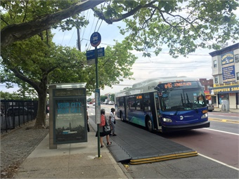 Testing out a temporary bulbout along Utica Avenue in Brooklyn. Image: TransitCenter