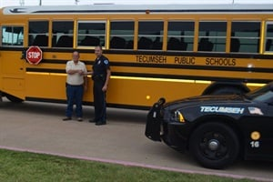 Tecumseh Transportation Director Teddy Kidney (left) says that working with law enforcement to crack down on illegal school bus passing has significantly raised awareness in the community. He is pictured with Trey Baker of the Tecumseh Police Department.