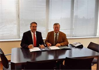 (From left to right) Dincer Celik, GM at TEMSA Global and Bob Foley, president/CEO at CH Bus Sales.