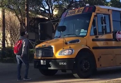Video footage shows the Texas driver driving the bus forward while the student stands in front of the bus asking to be let on board. Screenshot from video posted on Facebook by Yazmin Rojas.