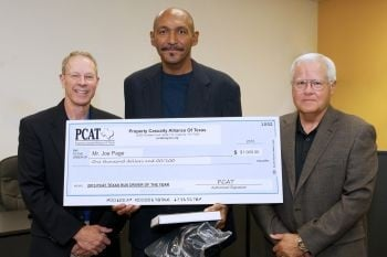 Joe Page (center) was named Texas Bus Driver of the Year by the Property Casualty Alliance of Texas (PCAT). He is pictured with PCAT's Emil Studinka (left) and Barry Rivers.