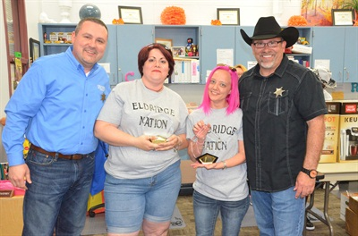 The Special Needs School Bus Safety Road-e-o winning team of driver Carol Jauer, second from left, and attendant Lisa Webb, third from left, receive their trophies from Bill Powell, left, and Robert McDaniel, right.
