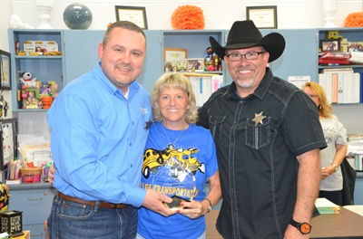 Bill Powell, left, director of transportation, and Robert McDaniel, training coordinator, present bus driver Becky Keeling with the first place trophy in the CFISD School Bus Safety Road-e-o on April 9.