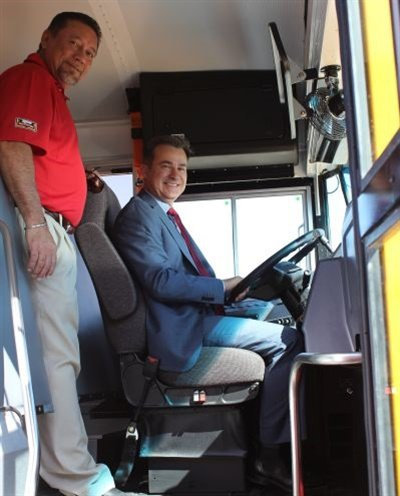 Texas state Rep. Roland Gutierrez gets behind the wheel of a Blue Bird school bus at the Rush Bus Centers event.