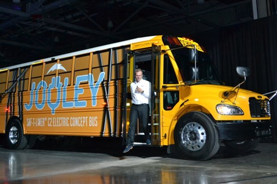 Thomas Built CEO Caley Edgerly surprises conference attendees by pulling up in a new electric school bus, dubbed Jouley.