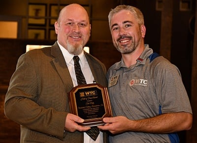 Tim Dietz accepts the WTC Lifetime Achievement Award from Chairman Tyson Boyer during the SEMA Show.