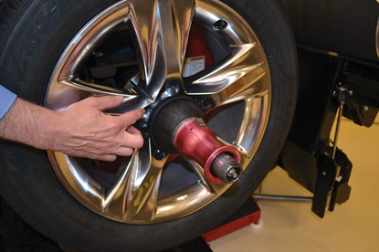Clad wheels are making a comeback, which means there's an increased risk of damaging the wheel. This photo shows where the clad is likely to crack if a clamp nut alone secures the wheel on the balancer.