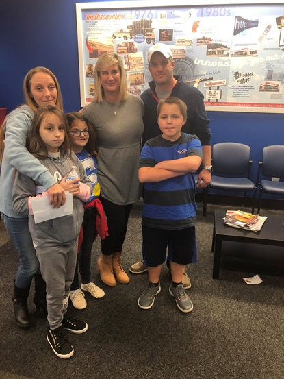 The Carey and Hosking families met at a Tire Discounters store in Louisville, and Catherine Carey drove away in her newly donated vehicle.