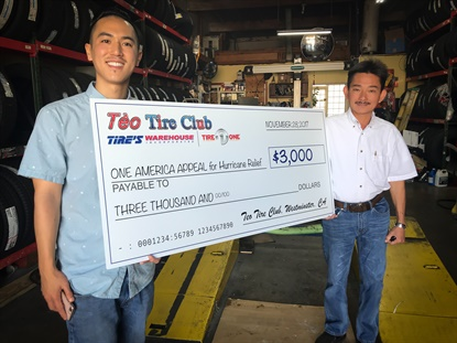 John Ton, right, and his son Bryant, left, turned their Tire's Warehouse winnings into a donation for hurricane relief.