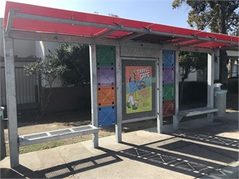 The vision for the transit shelters was to take the rugged steel structure and enhance and soften the lines with colorful acrylic roof panels and other artistic elements.