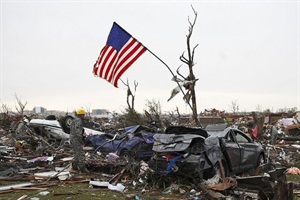 Members of the Oklahoma National Guard conduct search and rescue operations after the tornado that ripped through Moore on Monday. Supplies are being brought to the victims via school bus. Photo courtesy The National Guard
