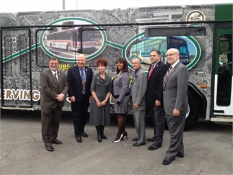 Transit Director Kim Turner (center) is joined by local officials for a photo opp.