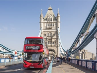 The iconic Tower Bridge and a red bus in London.