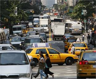 Manhattan traffic image by ILMRT via Wikimedia Commons.