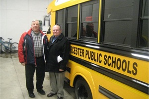 Tom Flynn (left), assistant transportation coordinator at Worcester (Mass.) Public Schools, and Ron Roe, president of Trans Tech Bus Sales and Service of New England, are pictured with one of the six SST school buses that were purchased for the district.