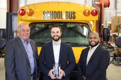 Leonard Bus Sales won Trans Tech's Dealer of the Year award. Shown here from left are Trans Tech President John Phraner, Leonard Bus Sales Vice President Jon Leonard, and Trans Tech National Sales Manager Erickson Lopez.