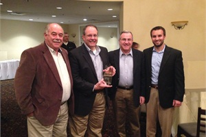 From left: John Phraner, president and CEO of Trans Tech Bus; Frank Continetti, sales director for Leonard Bus Sales, with the Dealer of the Year award; Chris O'Hara, operations manager of Leonard Bus Sales; and Jon Leonard, marketing director.