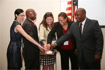 Mobility summit officials celebrate the launch of TransPortal. (L-R) Katie Ross, Sen. Bill Nelson's office; Glenel Bowden, CongresswomanCorrine Brown's office; Jessica Norfleet, Congressman Ted Yoho's office;Dr. Yvette Taylor, FTA Regional Administrator; and Nathaniel P. Ford Sr., JTA Chief Executive Officer.