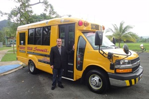 José E. Rodriguez, president and CEO of Transporte Sonnell, poses with one of the company's new Trans Tech small buses.