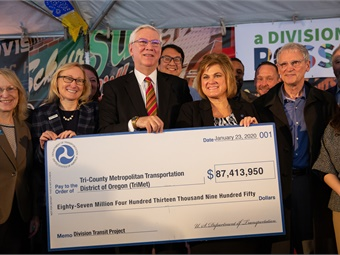 TriMet GM Doug Kelsey (center) and FTA Acting Administrator K. Jane Williams (right) were on hand to celebrate funding for the Division BRT project.TriMet