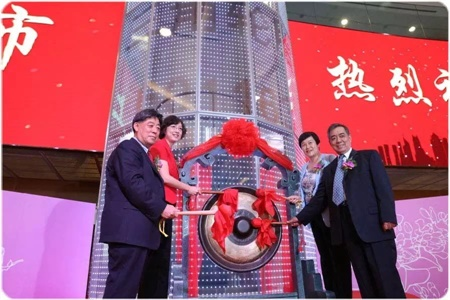 Triangle Group Chairman Yuhua Ding is shown at far left on Sept. 10, 2016, which was the first day the company was listed on the Shanghai Stock Exchange.