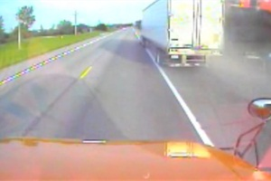 Video footage from the bus shows the truck passing the stopped school bus. The door can be heard opening and the semi passes, prompting the bus driver to exclaim and honk his horn.
